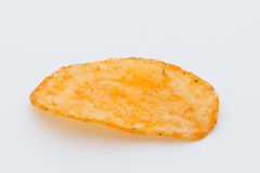 Chips med paprica på en vit bakgrund Royaltyfri Bild