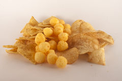 Chips, nachos and cheese balls. On white background Royalty Free Stock Image