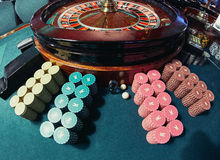 Chips near roulette. Close up of piles of chips near the roulette at the gambling club Stock Photography