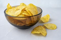 Chips with onions. A bowl of potato chips on a grey background. Chips with onions. A bowl of potato chips on a grey background royalty free stock photography