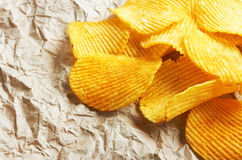 Chips on paper Stock Photos