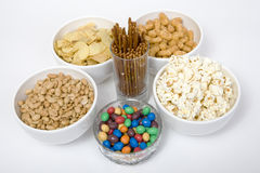 Chips peanuts popcorn salted sticks Stock Photos