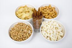 Chips peanuts popcorn salted sticks Stock Photo