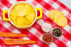 Chips, peppers and ketchup Royalty Free Stock Photo