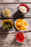 Chips and pickles with sauerkraut. Royalty Free Stock Images