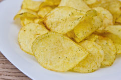 Chips on a plate. Closeup Stock Photography