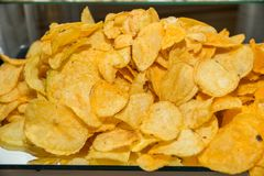 Chips on a plate royalty free stock photos