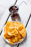 Chips on plate and cola. Stock Image
