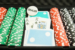 Chips and playing cards in the case Stock Images