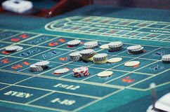 The chips on the playing field. Detail of a green roulette table with some numbers Royalty Free Stock Images