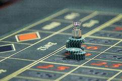The chips on the playing field. Detail of a green roulette table with some numbers Royalty Free Stock Photography