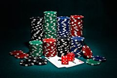 Chips for poker with pair of aces and dice. Stacks of chips for poker with pair of aces and dice royalty free stock photos