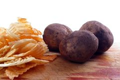 Chips and potatoes on board. Crisps or chips and potatoes on board Stock Photo