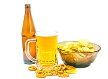 Chips, pretzels and beer closeup Royalty Free Stock Photo