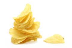 Chips pyramid and single chip. On the white background Royalty Free Stock Photography