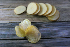 Chips and raw potatoes Stock Photos
