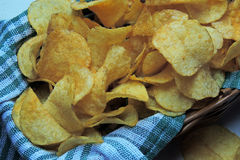 Chips and raw potatoes Stock Image