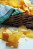 Chips and raw potatoes Stock Photo