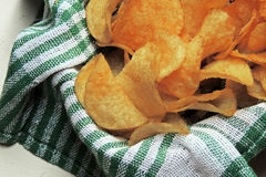 Chips and raw potatoes Stock Images