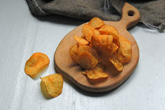 Chips and raw potatoes Royalty Free Stock Photography