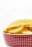 Chips in the red bowl Royalty Free Stock Photography