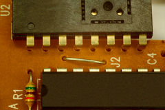 Chips and resistor. Electronic components on printed circuit board Stock Images