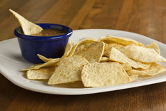Chips and Salsa. A plate of chips with salsa in a bowl Stock Images
