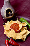 Chips, salsa and peppers Royalty Free Stock Images