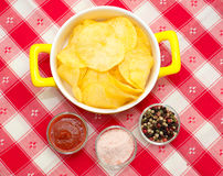 Chips salt, pepper and ketch-up Stock Photography