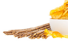 Chips and Saltsticks (with clipping path). Group of Chips and Saltsticks isolated on white background (with clipping path Royalty Free Stock Photography