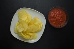Chips with sauce Stock Images
