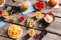 Chips with sauerkraut and burgers. Stock Images