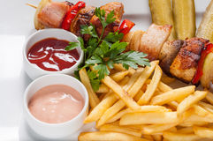 Chips and skewers Stock Photo