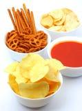 Chips, snacks en onderdompeling Stock Fotografie