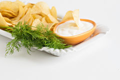 Chips with sour cream and dill sauce isolated.  Stock Photos