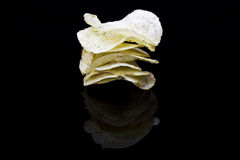 Chips stack on black surface Royalty Free Stock Photo