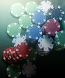 Chips stack and four of kind poker combination on a green background. Royalty Free Stock Photo