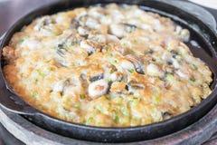 Chips stekte musslapannkakor Arkivbild