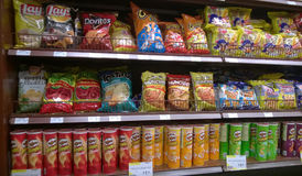 Chips on store shelves. Junk food chips on supermarket  store shelves USA Stock Photo