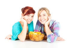 Chips and teenage girl friends Royalty Free Stock Photography
