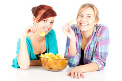 Chips and teenage girl friends Stock Image