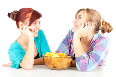 Chips and teenage girl friends Stock Photos
