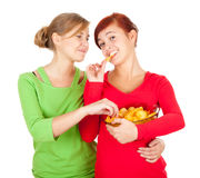 Chips and teenage girl friends Royalty Free Stock Photo
