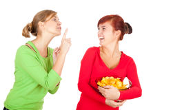 Chips and teenage girls friends Royalty Free Stock Images