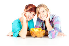 Chips and teenage girls friends Royalty Free Stock Photo