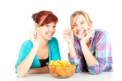 Chips and teenage girls friends Royalty Free Stock Photos