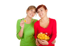 Chips and teenage girls friends Royalty Free Stock Photography