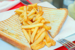 Chips between toast. Fast food Stock Photos