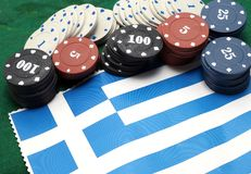Chips tokens for gambling over the flag of Greece Royalty Free Stock Photos