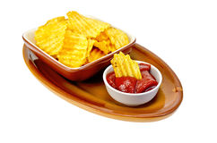 Chips in tomato sauce on a clay plate Stock Photography